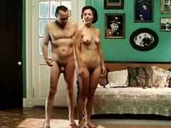 Amy Irving standing naked in front of..
