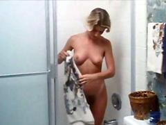 Barbara Peckinpaugh undressing on bed