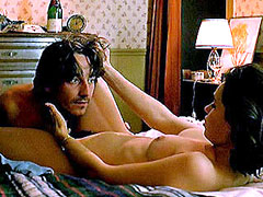Beatrice Dalle undressing on bed and..
