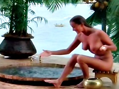 An American actress Bo Derek naked sitting in jacuzzi