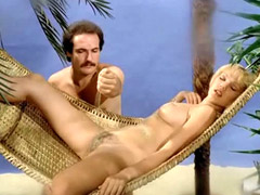 Brigitte Lahaie laying while a guy..