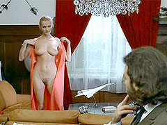 Brigitte Lahaie fully undresses and..