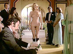 Sexy blonde Brigitte Lahaie fully naked on swing party
