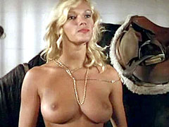 Fully naked Brigitte Lahaie spreads..