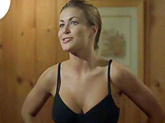 Carmen Electra removes her bra and..