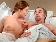 Carole Bouquet removes her nightie and talking with guy in bed