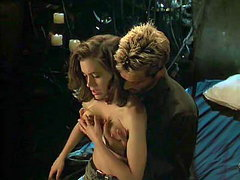 Alyssa Milano sitting in a guy's lap as he undoes her bra and then reaches around to squeeze her..