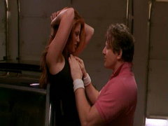 Angie Everhart wearing a black tanktop..