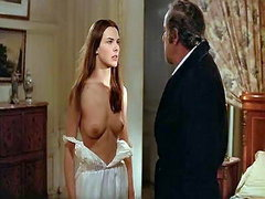 Carole Bouquet standing in front of a..