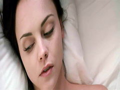 Christina Ricci on her back in bed..