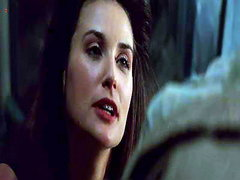 Demi Moore straddling Michael Douglas as she seduces him and then going down on her knees to give..