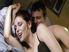 Diora Baird lying on her side in bed..