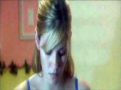 Elisha Cuthbert standing at an ironing..