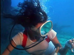Jacqueline Bisset scuba diving in a..