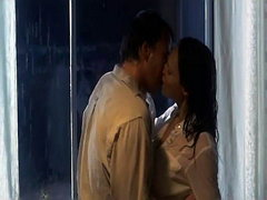 Jolene Blalock making out with a guy as they undress. We then see her nude on top of him in bed,..