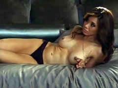 Judy Greer undressing next to a bed,..