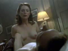 Julianne Moore moaning as she has sex with a guy, laying back on a couch. Then we see Julianne..
