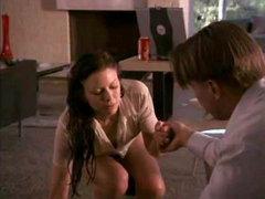 Kari Wuhrer taking off her wet shirt..
