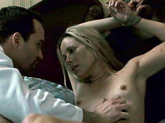 Maria Bello lying naked on a bed,her..