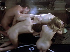 Mariana Karr and Sandra Alberti both naked with two guys in group hot sex scene. From Satans Blood.