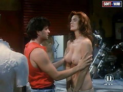 Shannon Tweed taking off her shirt to..
