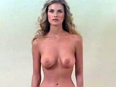 Former Playboy Playmate of the Year Terri Welles shown topless from a few different angles as she..