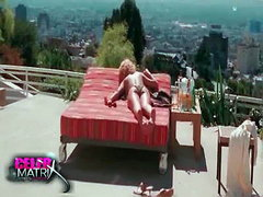 Uma Thurman lying face down topless..