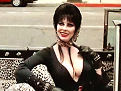 Gorgeous Elvira flashing great boobs in movie caps