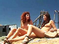 Eva Derrek sunbathing topless witn..