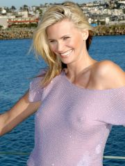 Natasha Henstridge posing in pool in..