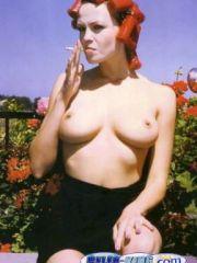 Sexy Olga Kurylenko shows her nice..