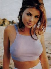bonny actress Yasmine Bleeth posing in..