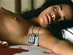 American actress Lisa Bonet layng nude in bed