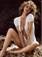 Adorable Eva Herzigova posing topless..