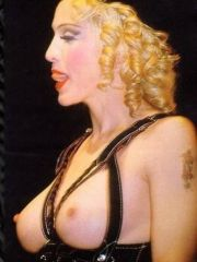 attractive singer Madonna shows her..