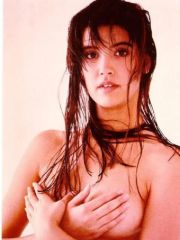 actress Phoebe Cates posing in bikini..