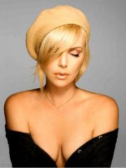 Charlize Theron shows her small perky..