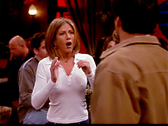 Jen Aniston in white thin top showing..