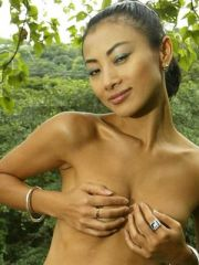 Hot Bai Ling exposes her tits in one of..