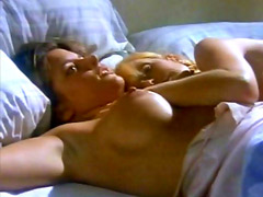 Actress Dana Plato nude laying on bed..