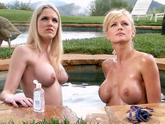 Busty Deanna Merryman and Kelli Summers topless standing in hot tub
