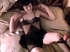 Diane Lane laying in sexy stockings on..