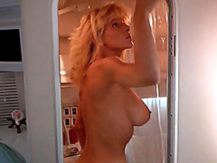 Busty Dona Speir removing her bikini and washing in shower on yacht