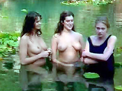 Elle MacPherson and Kate Fischer showing breasts in pool of water
