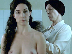 Elsa Zylberstein standing topless and..
