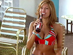 Eva Mendes showing nice cleavage in red bikini top and very short shorts