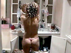 Naked Geri Halliwell undresses, spy..