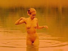 Hanne Klintoe emerging from a lake..