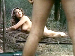 Fully naked Janet Wood plays with big..