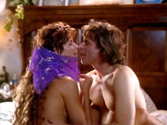 Joan Severance topless sitting in bed..